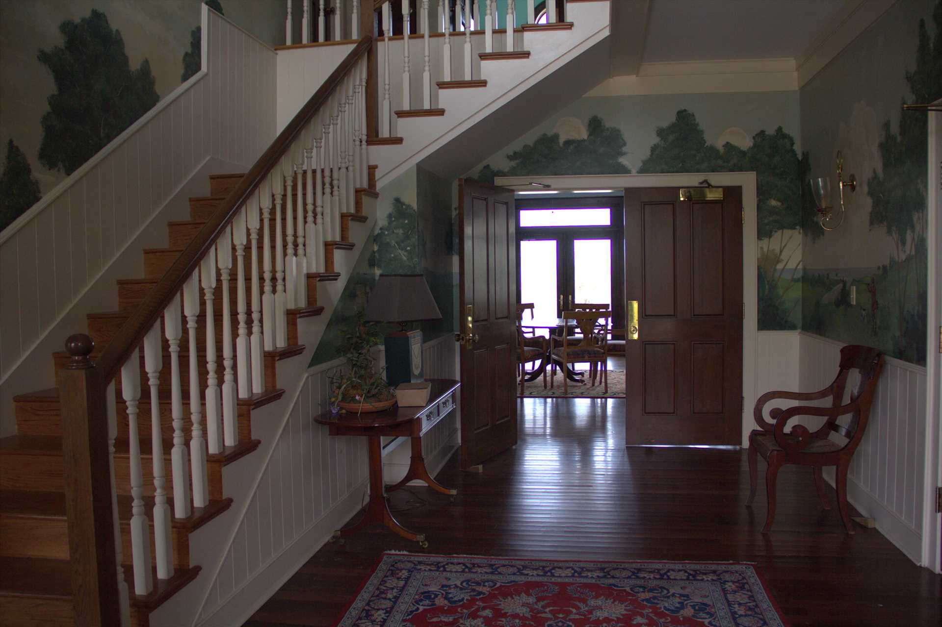 You will find a grand staircase and hand painted murals.