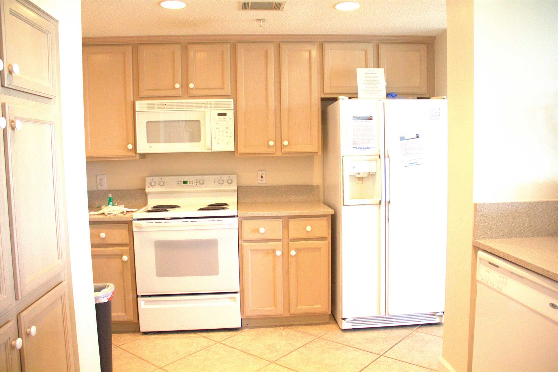 The kitchen comes equipped with a stove, fridge, microwave a