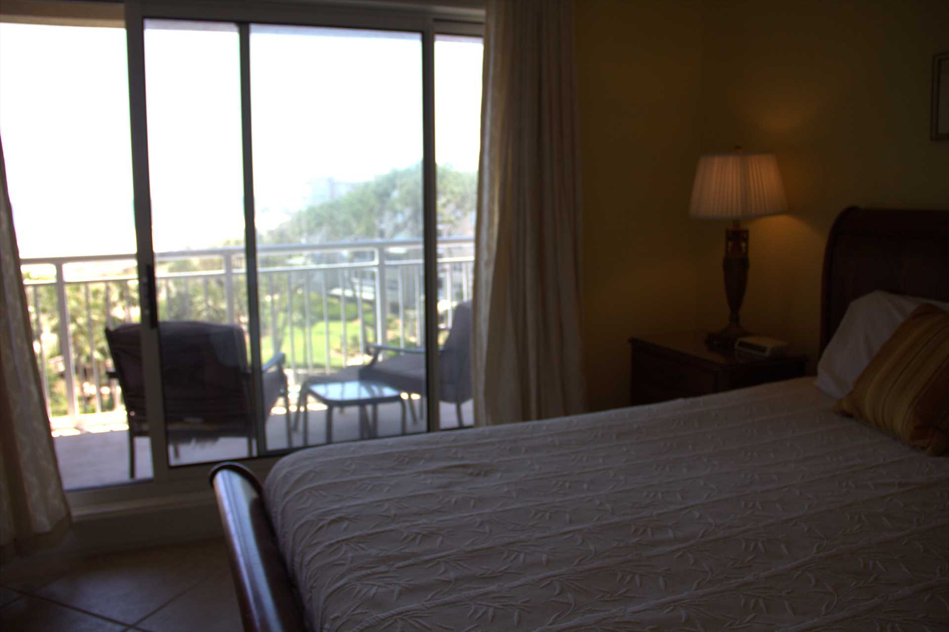 From the bed in this master bedroom you can see the ocean