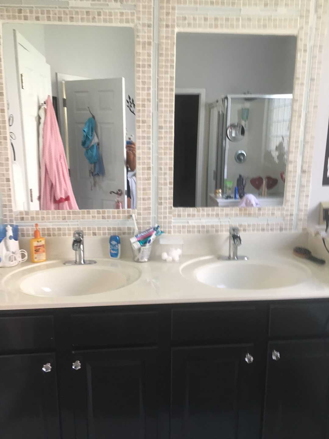 This is the master bathroom with double sinks, a garden tub