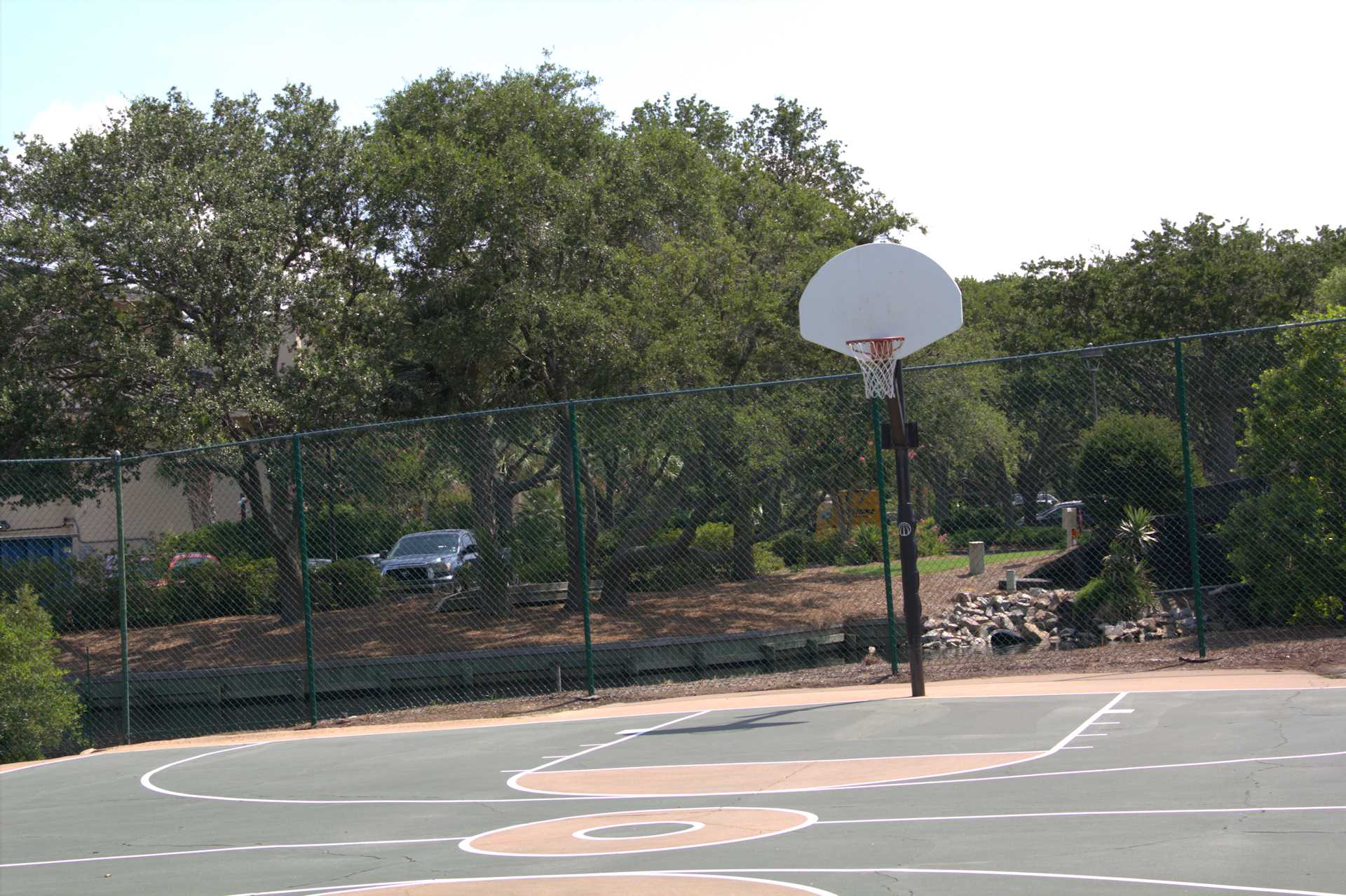 There is a basket ball court near the exercise room