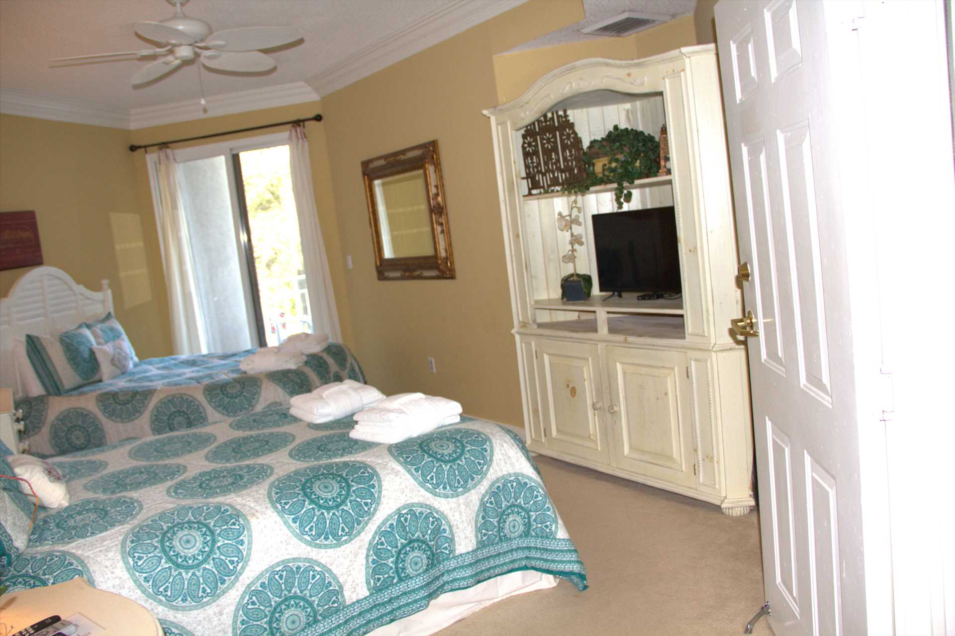 This bedroom has 2 queen beds with a private bathroom