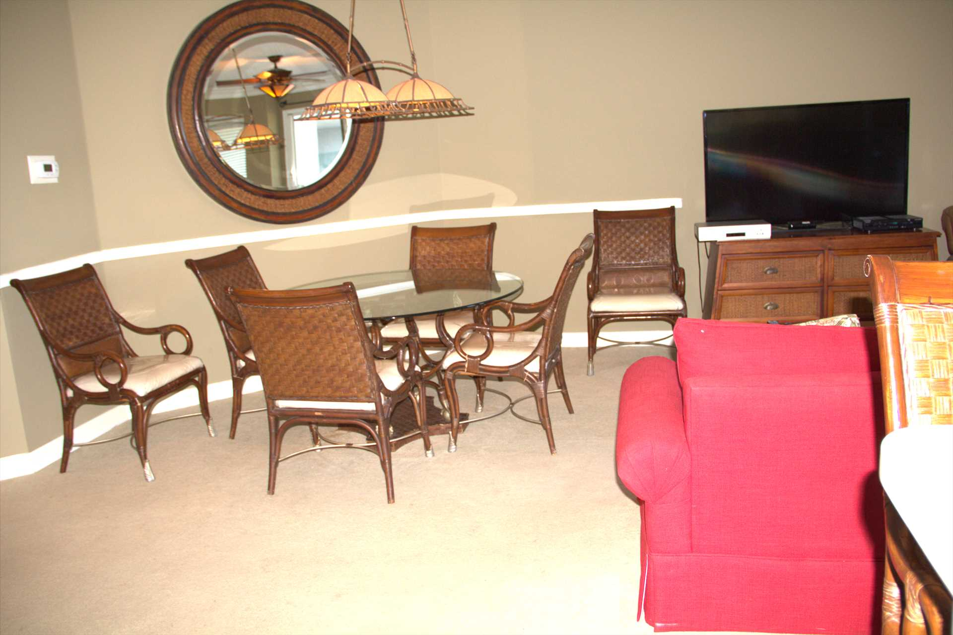 The dining room table sits 6