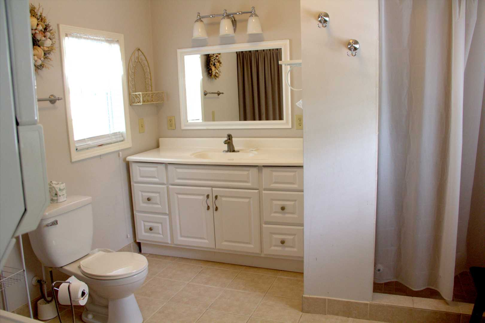Bathroom off the family room with shower